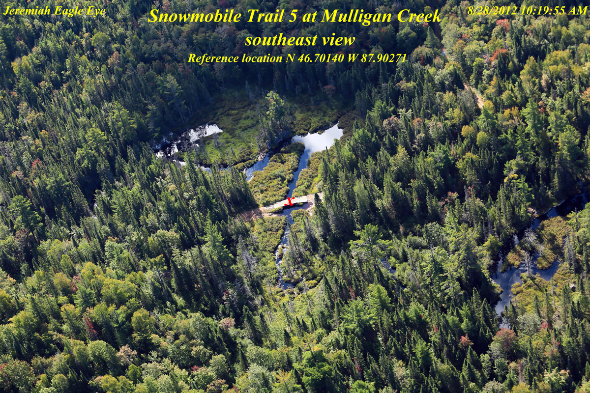 Aerial view of Mulligan Creek, showing the Snowmobile Trail #5 crossing, proposed route of County Road 595. Photo by Jeremiah Eagle Eye.